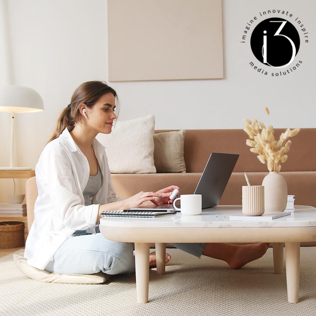 Woman Sitting On Floor Using Laptop Image